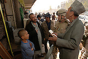 Mr. Mohammad Essaq (right), translates for Master Sgt. Fox, to ask Mr. Hajy Nazar Mohammad (second from left), shopkeeper, if he has a different size of bailing wire for a 4 April 2006 local purchase that will support the U.S. Air Force and the Afghanistan National Army (ANA). Master Sgt. Fox, an Embedded Training Team (ETT) member, is a native of Lubbock, Texas, deployed to the 755th Expeditionary Mission Support Group, Detachment 2, Camp Eggers, Kabul, Afghanistan, from the 49th Maintenance Squadron, Holloman Air Force Base, NM. Sgt. Fox is a member of the U.S. Air Force Embedded Training Team (EET) who will advise, train and mentor Afghanistan National Army personnel on the U.S. Army logistics standard and methods.  The purchase of needed supplies and personal protection equipment will allow the ETT to continue mentoring the ANA, and for the ANA to operate safely and prepare for future missions. At the Central Workshop, reconditioning of small arms such as AK-47 rifles to field artillery repairs are performed. The funds for the purchases come from Field Ordering Officer funds that are used if items are not available from the Office of Security Cooperation-Afghanistan (OSC-A) or ANA supply systems in the time required -- purchases can not exceed $2,500.  The U.S. Air Force provides specialized personnel to fill U.S. Army request for forces.  This supports the OSC-A in its partnership with the Government of Afghanistan and the International Community to plan, program, and implement reform in Defense Sectors, develop a stable Afghanistan, and deter and defeat terrorism within its borders. (U.S. Air Force photo/Master Sgt. Lance Cheung)<br />