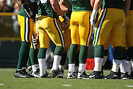 GREEN BAY, WI - OCTOBER 17: Players of the Green Bay Packers in the huddle against the Miami Dolphins at Lambeau Field on October 17, 2010 in Green Bay, Wisconsin. The Dolphins defeated the Packers 23-20 in overtime. (Photo by Tom Hauck/Getty Images) *** Local Caption ***
