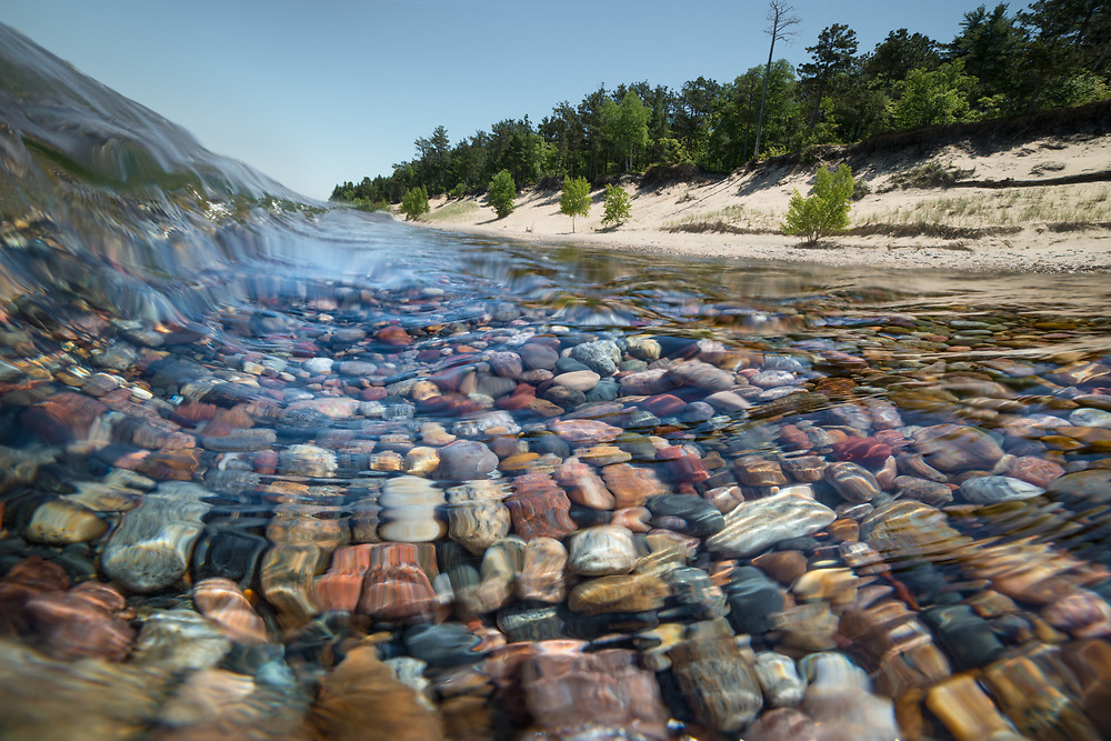 Lake Superior shows its crystal clear water and its beautiful rocks just below the surface.