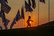 A boy walks through amongst 3,000 US flags are displayed at Pepperdine University to mark the 12th anniversary of the 9/11 terror attack, September 10, 2013 in Malibu, California. Photo by Ringo Chiu/PHOTOFORMULA.com)