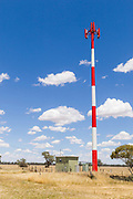 Red and white cellular antenna and pole tower <br /> <br /> Editions:- Open Edition Print / Stock Image