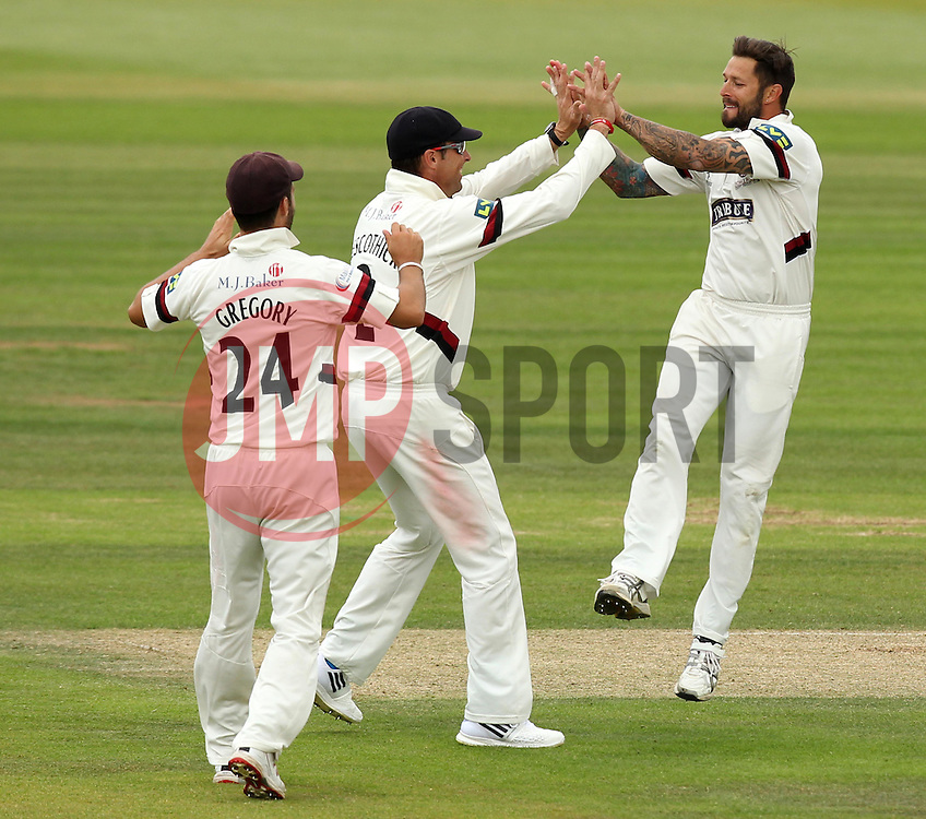 Somerset's Peter Trego celebrates taking the wicket of Hampshire's Liam Dawson with Somerset's Marcus Trescothick - Photo mandatory by-line: Robbie Stephenson/JMP - Mobile: 07966 386802 - 23/06/2015 - SPORT - Cricket - Southampton - The Ageas Bowl - Hampshire v Somerset - County Championship Division One