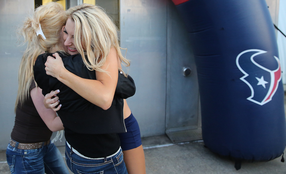 4/16/2014: Brittany M. hugs her mother Kathy Perrish and her step sister Brittany Perrish after they found out she made the squad. This was Brittany fourth year trying out for the team. Fifty girls showed up on April 16, 2014 at the Houston Texans practice facility in Houston, Texas to see which 35 girls made the 2014-2015, Houston Texans Cheerleading Team.