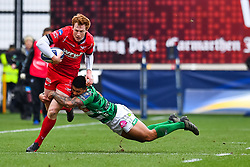 Scarlets' Rhys Patchell is tackled by Benetton Treviso's Monty Ioane<br /> <br /> Photographer Simon King/Replay Images<br /> <br /> EPCR Champions Cup Round 3 - Scarlets v Benetton Rugby - Saturday 9th December 2017 - Parc y Scarlets - Llanelli<br /> <br /> World Copyright © 2017 Replay Images. All rights reserved. info@replayimages.co.uk - www.replayimages.co.uk