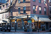 Street scene of young woman strolling in the shopping district of Charles Street and Chestnut Street in Beacon Hill historic district, Boston, USA