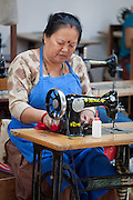 A Nepali woman operates a sewing machine at Womens Skills Development Project in Pokhara, Nepal. The WSDP was set up in 1975 as a non-profit, fair trade organization to help disadvantaged women in Nepal.