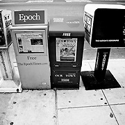 News Paper Stands on a Sidewalk. Black and White