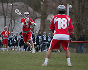 Matt Boseck of Canandaigua passes to teammate Connor Hulme during a game against Pittsford on Saturday, April 11, 2015.