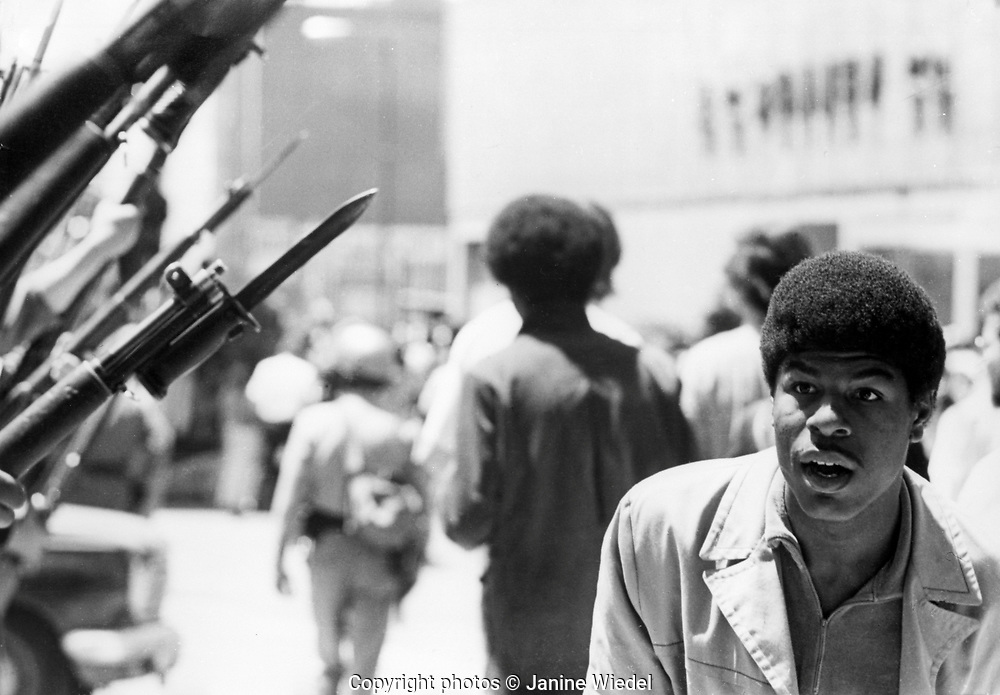 Bayonettes pointed at young black man by US National guard during Berkely riots in 1969