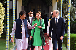 The Duke and Duchess of Cambridge walk alongside the Prime Minister of Pakistan Imran Khan during a visit to his official residence in Islamabad on the second day of the royal visit.