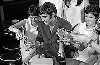 Manchester United soccer star, George Best, shares a glass of bubbly with fans at the opening of the Mint Imperial Discotheque in Belfast, N Ireland. 196801000031b, 31/68.<br />