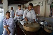 Buddhist Nuns at temple in Samut Songkram. Preparing food on a Sunday morning.