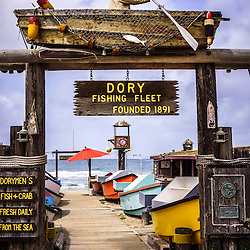 Photo of the Dory Fishing Fleet Market in Newport Beach California. The Dory Fishing Fleet is a historic landmark located on Balboa Peninsula in Orange County Southern California and is a public market where dory fisherman sell their daily catch. The photo is vertical, high resolution and was taken in 2012.