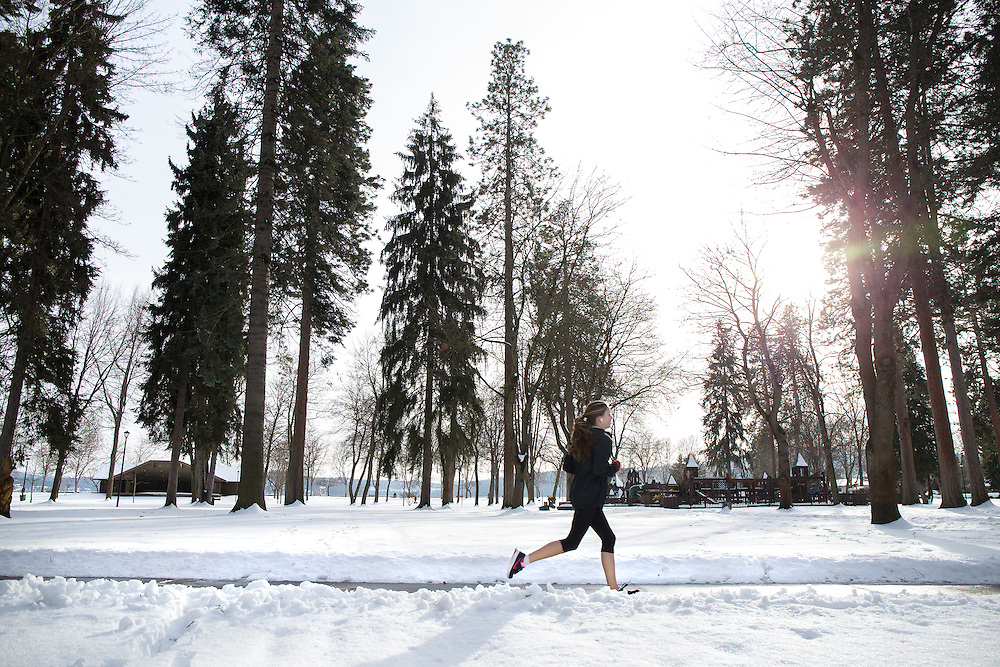 GABE GREEN/Press<br /> <br /> A young woman jogs through Coeur d&rsquo;Alene City Park in the mid-afternoon Tuesday.