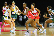 England's Sasha Corbin looks to pass the ball against South Africa in the New World Quad series netball match, Claudelands Arena, Hamilton, New Zealand, Thursday, November 01, 2012. Credit:NINZ / Dianne Manson.