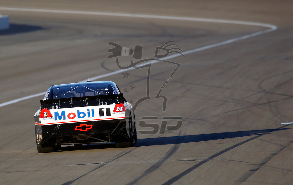 LAS VEGAS, NV - MAR 09, 2012:  Tony Stewart (14) qualifies for the Kobalt Tools 400 race at the Las Vegas Motor Speedway in Las Vegas, NV.