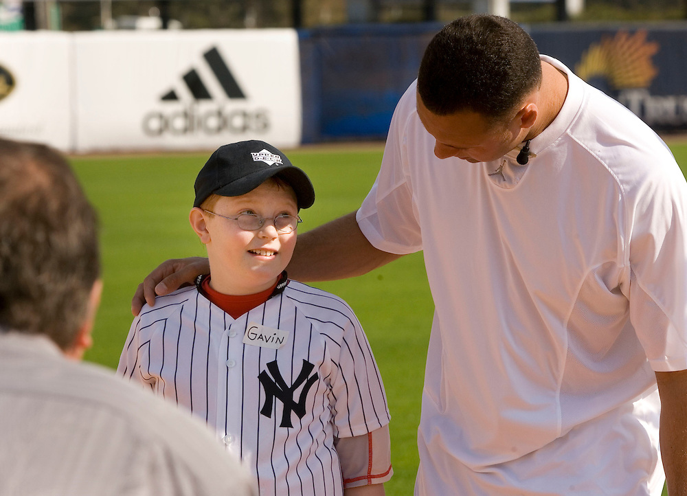 """Gavin Leonard,9, of Bristol, Virginia admires New York Yankee's Derek Jeter while posing for a photo during the Upper Deck, """"Play Ball! with Derek Jeter"""" clinic on Saturday, February 10, 2007 at Legends Field in Tampa, Florida.  Justin Topa, 15, of Binghampton, New York, Jordan Boone, 10, of Las Vegas, Nevada, Bryce Porter, 10, of Costa Mesa, California and Gavin Leonard, 9, of Bristol, Virginia, each won the grand prize to meet Jeter through various promotions on www.UpperDeckKids.com in 2006. UPPER DECK/Scott Audette"""