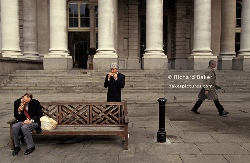Two City businessmen eat their takeaway sandwiches at Cornhill in the City of London, on 16th June 1994, in London, England.