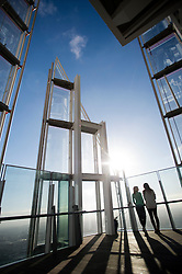 **PICTURES STRICTLY EMBARGOED INTIL 00:01 HOURS FRIDAY 11 JANUARY 2013** © London News Pictures. London, UK.  Two women looking at the London Skyline during a media preview of the viewing level of The Shard building in London ahead of the public opening of 'A View From The Shard' on February 1, 2013. The public can view a 360 degree view of the capital from the 72nd floor of Western Europe's tallest building which stands at 800ft (244m).  Photo credit : Ben Cawthra/LNP