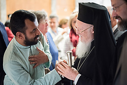 His All Holiness Bartholomew I (right) greets one of the students at the World Council of Churches Ecumenical Institute at Bossey (left). The Ecumenical Patriarch, His All Holiness Bartholomew I, delivered a public address at the Ecumenical Centre in Geneva on 24 April as part of his official visit to Switzerland on the occasion of the 25th anniversary of his enthronement as Ecumenical Patriarch and the 50th anniversary of the Orthodox Centre of the Ecumenical Patriarchate in Chambésy.