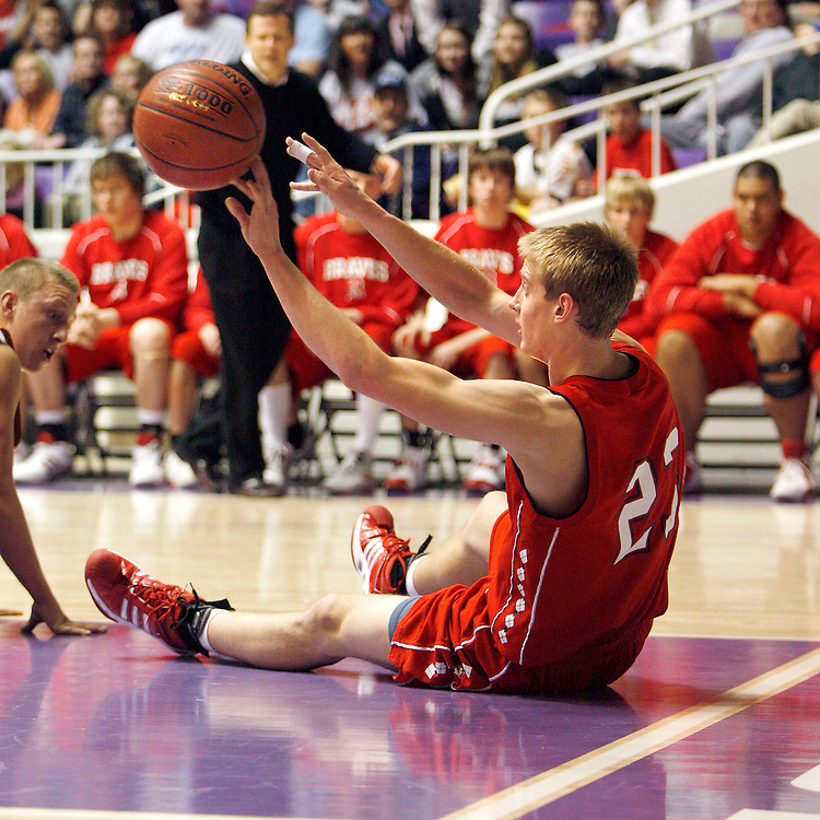 Bountiful's Travis Parrish comes up with a loose ball and passes it to a team mate while sitting on the floor with he plays against Murray in the 2nd round game of the 4A State High School Basketball Championships at the Dee Events Center in Ogden, Utah, Thursday 28, 2008.  August Miller/ Deseret Morning News
