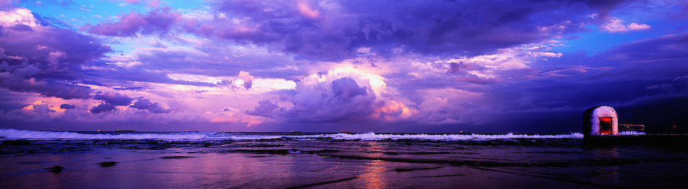 Setting sun reflecting off clouds,Ocean Baths, East Coast Australia