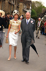 LADY JANE SPENCER-CHURCHILL and JOHN BOWES-LYON at the wedding of Laura parper Bowles to Harry Lopes held at Lacock, Wiltshire on 6th May 2006.<br />