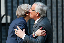 © Licensed to London News Pictures. 26/04/2017. London, UK. UK Prime Minister THERESA MAY welcomes Head of the European Commission, President JEAN-CLAUDE JUNCKER to No10 Downing Street in London on 26 April 2017. Photo credit: Tolga Akmen/LNP
