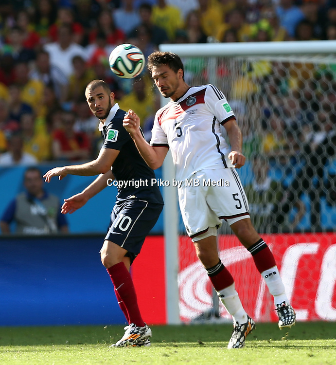 Fifa Soccer World Cup - Brazil 2014 - <br /> FRANCE (FRA) Vs. GERMANY (GER) - Quarter-finals - Estadio do Maracana Rio De Janeiro -- Brazil (BRA) - 04 July 2014 <br /> Here French player Karim BENZEMA (L) and German player Mats HUMMELS (R)<br /> &copy; PikoPress