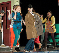 Street vendor Devon Sweeney strolls down skid row followed by the Ronettes Kathy Lipshultz, Jennie Veloski, Katie Tarr and Nicole Rosas during Belmont High School's dress rehearsal for Little Shop of Horrors Wednesday evening.   Performances will be Thursday through Saturday night at 7 pm at the Belmont Middle School.  (Karen Bobotas/for the Laconia Daily Sun)