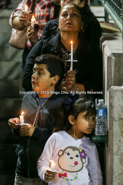Thousands people gather to pray for the victims of San Bernardino Mass Shooting during a Candlelight Vigil at San Manuel Stadium in San Bernardino, California, Thursday, December 3, 2015. (Photo by Ringo Chiu/PHOTOFORMULA.com)<br /> <br /> Usage Notes: This content is intended for editorial use only. For other uses, additional clearances may be required.