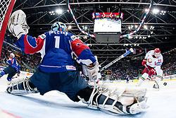 Andrei Stas of Belarus vs Andrej Hocevar, goalkeeper of Slovenia during ice-hockey match between Slovenia and Belarus of Group G in Relegation Round of IIHF 2011 World Championship Slovakia, on May 8, 2011 in Orange Arena, Bratislava, Slovakia. (Photo by Matic Klansek Velej / Sportida)