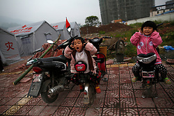 Children play outside temporary shelter tents in Lushan County of Ya'an,Sichuan Province, China, 22 April 2013. The Lushan Earthquake in Sichuan Province on 20 April 2013 resulted in 186 people dead, 21 missing, 11248 injured. About 1.72 million people were affected by the quake, while an initial estimate by the International Red Cross on Saturday put the number needing emergency shelter, water and food at 120,000. The China Earthquake Administration (CEA) recorded a magnitude 7.0 earthquake, while the US Geological Survey said it had measured 6.9.