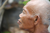 Close-up of a monk watching a cremation in Bali, Indonesia.