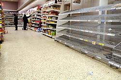 © under license to London News Pictures.3.12.2010 Empty shelves at a superstore in Sidcup, Kent. Snow in Kent. Picture credit should read Grant Falvey/London News Pictures