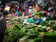 01 JUNE 2016 - SIEM REAP, CAMBODIA:  A vendor sells fresh produce in the Siem Reap market. There are growing concerns that spot food shortages, especially of fish, the Cambodians main source of protein, could become worse if the coming rainy season doesn't bring relief from the drought that has gripped Cambodia for the last two years.          PHOTO BY JACK KURTZ