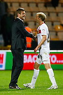 MK Dons Manager Karl Robinson celebrates victory  with 2 goal hero Luke Chadwick at the end of the Carling Cup 2nd Round match at Carrow Road Stadium, Norwich, Norfolk...Picture by Paul Chesterton/Focus Images Ltd.  07904 640267.23/8/11