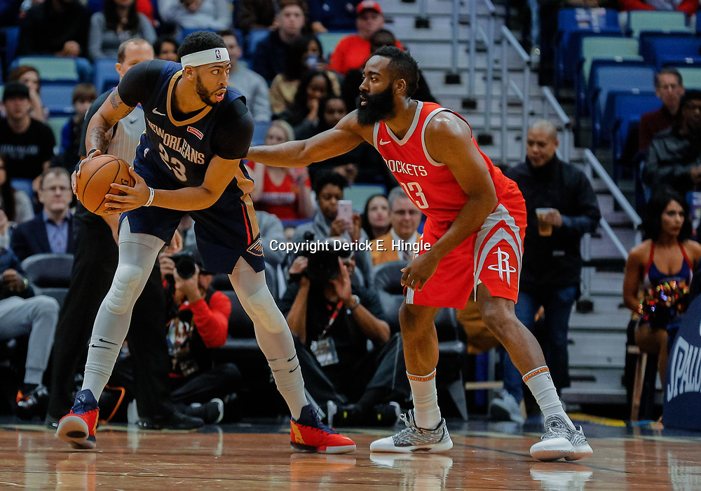 Jan 26, 2018; New Orleans, LA, USA; New Orleans Pelicans forward Anthony Davis (23) is defended by Houston Rockets guard James Harden (13) during the first quarter at the Smoothie King Center. Mandatory Credit: Derick E. Hingle-USA TODAY Sports