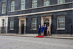 © Licensed to London News Pictures. 04/06/2019. London, UK. President of the United States Donald Trump and Melania Trump are greeted by Prime Minister Theresa May and Phillip May as they arrive on Downing Street. President Trump is in the UK for a three-day State Visit. Photo credit: Rob Pinney/LNP