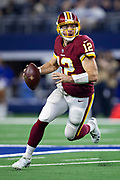 ARLINGTON, TX - NOVEMBER 22:  Colt McCoy #12 of the Washington Redskins rolls out to pass during the second half of a game against the Dallas Cowboys at AT&T Stadium on November 22, 2018 in Arlington, Texas.  The Cowboys defeated the Redskins 31-23.  (Photo by Wesley Hitt/Getty Images) *** Local Caption *** Jay Gruden
