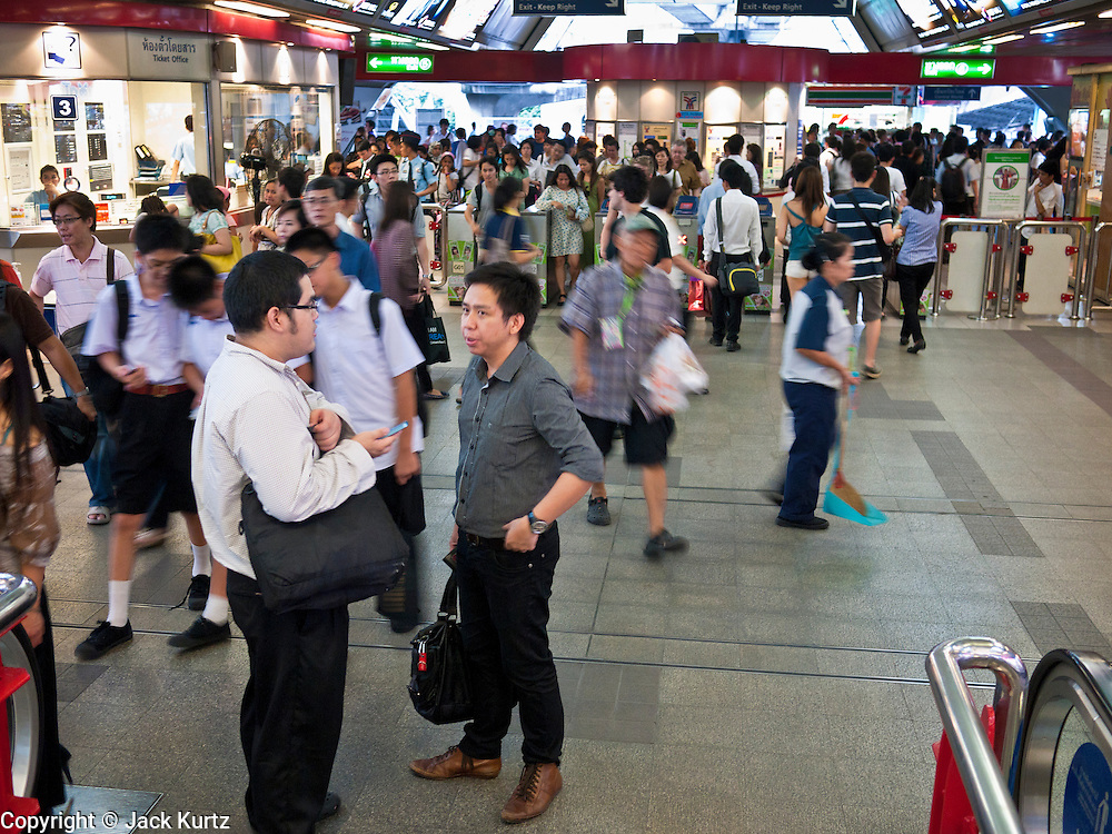 """08 JULY 2011 - BANGKOK, THAILAND: People pass through the Siam station of the BTS or Skytrain in Bangkok, Thailand. Bangkok's """"Skytrain"""" system, officially called the BTS, cuts across the city from the Chao Phraya River to the Weekend Market.   PHOTO BY JACK KURTZ"""