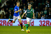 Daryl Horgan (#7) of Hibernian on the ball pursued by Gareth McAuley (#36) of Rangers during the Ladbrokes Scottish Premiership match between Hibernian and Rangers at Easter Road, Edinburgh, Scotland on 19 December 2018.