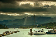 Storm light and mountains at Skidegate<br />Haida Gwaii<br />British Columbia<br />Canada
