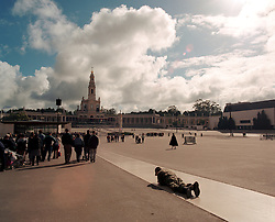 Catholic faithful crawl on hands and knees in pilgrimage to the statue of the Madonna of Fatima