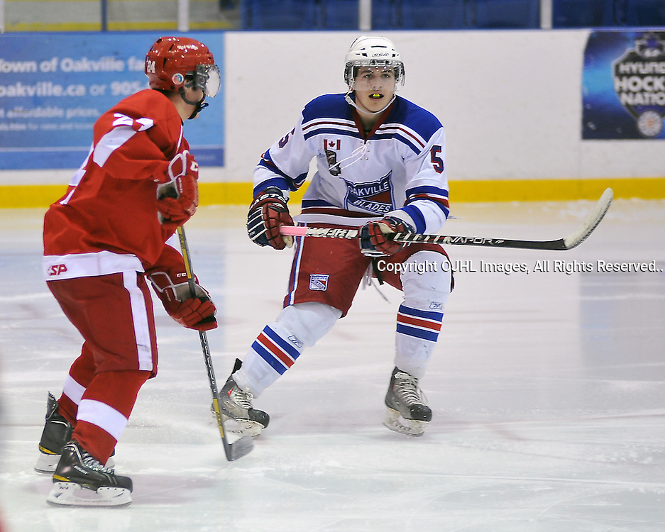 OAKVILLE, ON - Jan 25 : Ontario Junior Hockey League game between Hamilton Red Wings and Oakville Blades. Harrison Domagala #5 of the Oakville Blades gets in position during second period game action..(Photo by Shawn Muir / OJHL Images)