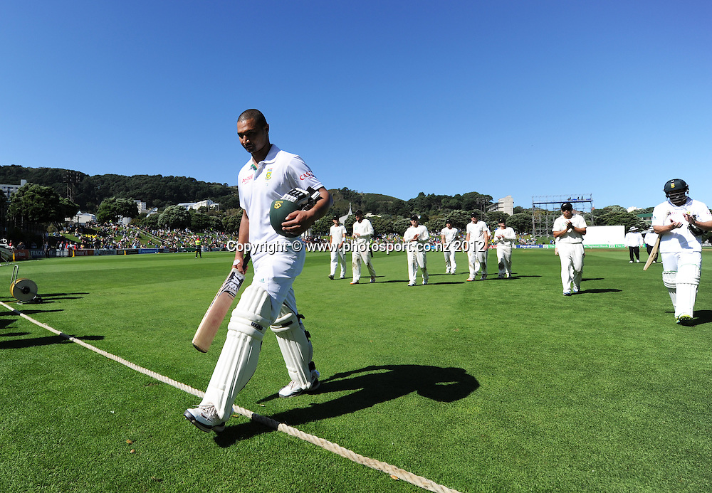 South Africa's Alviro Petersen leads the players off the field as the teams head for lunch. Test match cricket. Third Test, Day 3. New Zealand Black Caps versus South Africa Proteas, Basin Reserve, Wellington, New Zealand. Sunday 25 March 2012. Photo: Andrew Cornaga/Photosport.co.nz