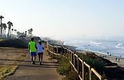 Couple Walking Along Beach Trail in Huntington Beach