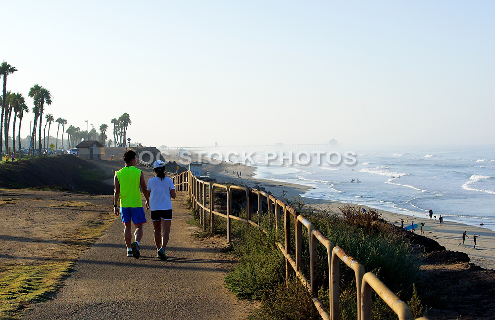 Couple Walking Along Beach Trail in Huntington Beach