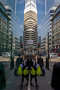 A symmetrical scene of London city workers out walking and shopping at lunchtime, with tall office buildings rising above.