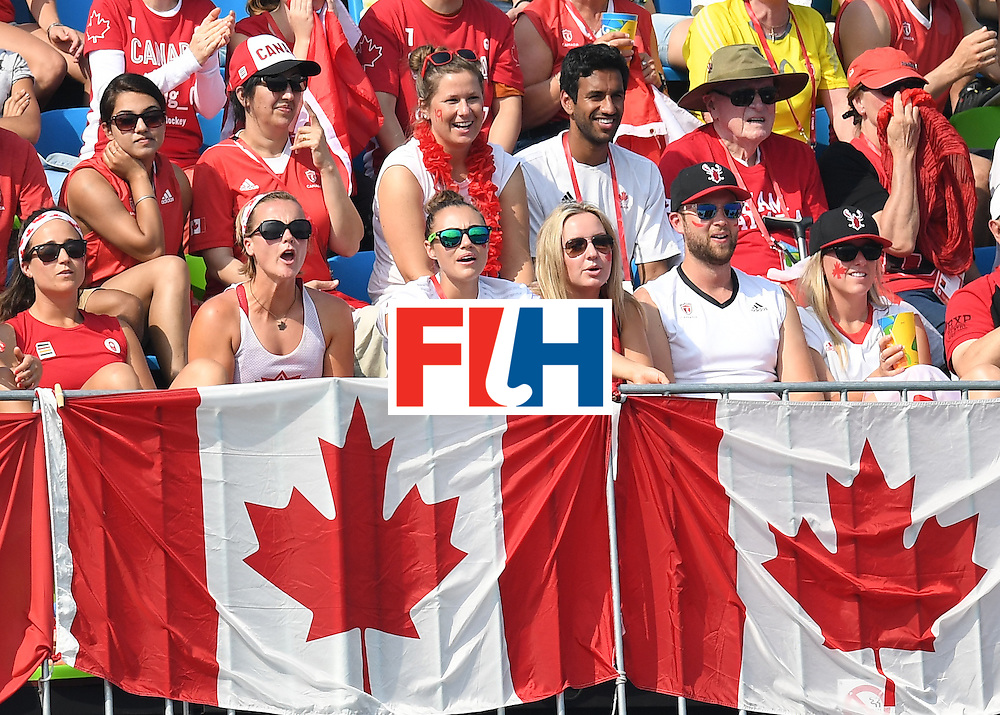 Canada fans watch the men's field hockey Netherlands vs Canada match of the Rio 2016 Olympics Games at the Olympic Hockey Centre in Rio de Janeiro on August, 9 2016. / AFP / MANAN VATSYAYANA        (Photo credit should read MANAN VATSYAYANA/AFP/Getty Images)